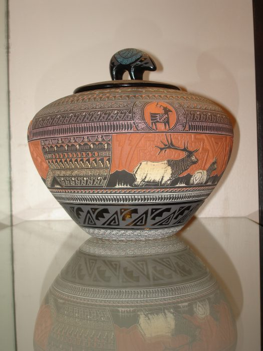 Pottery vase with Native American designs