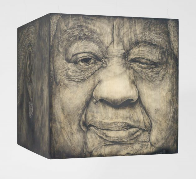 Cube with portrait of old woman