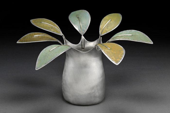 Vase with metal petals