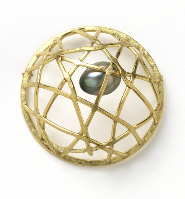 Gold basket with pearl egg