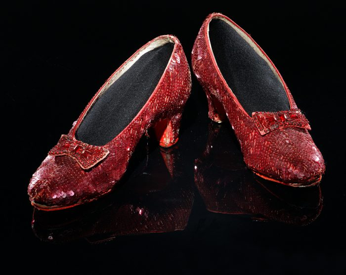 Sequinned shoes photgraphed on black background