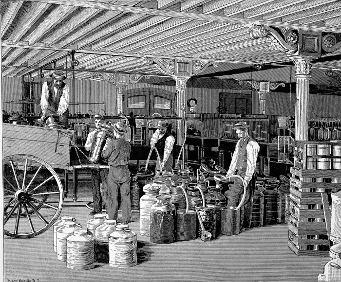 Engraving of workers loading tanks onto a wagon in a warehouse
