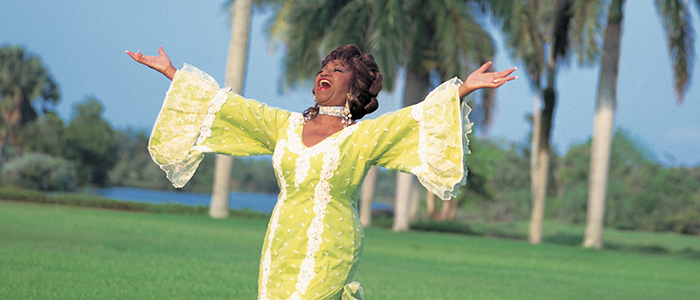 cropped photo of Celia Cruz in yellow tango dress