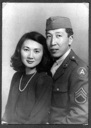 Formal portrait young couple, man in uniform