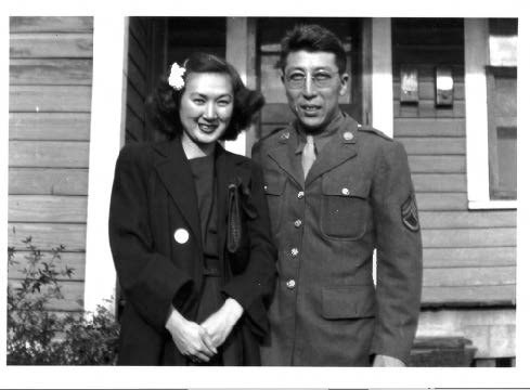 Snapshot of young couple standing in front of house