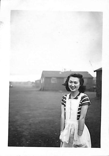 Young Japanese American woman smiles at camera