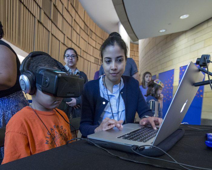Child wearing virtual reality headgear