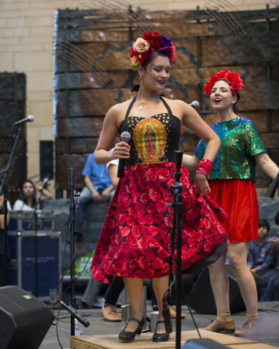 Performers in colorful costumes