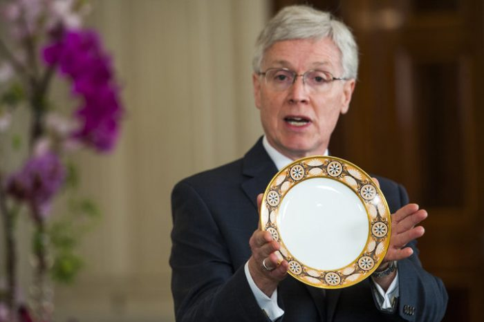 white-haired man with plate