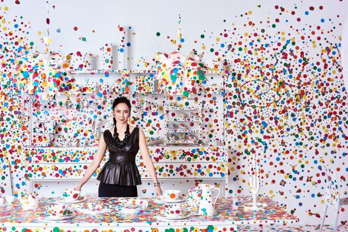 Chiu, dressed in black in polka-dot strewn room