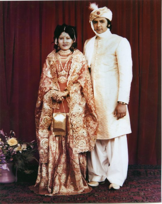 Formal portrait of Pakistani couple in wedding apparel