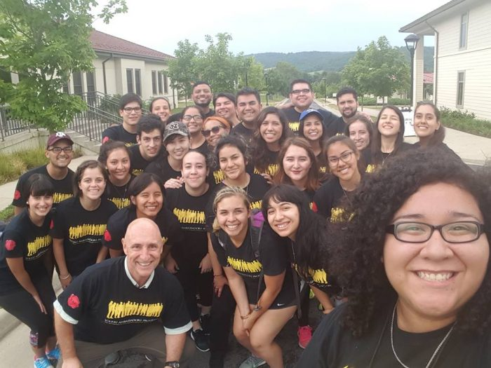 group in matching tshirts poses for a selfie