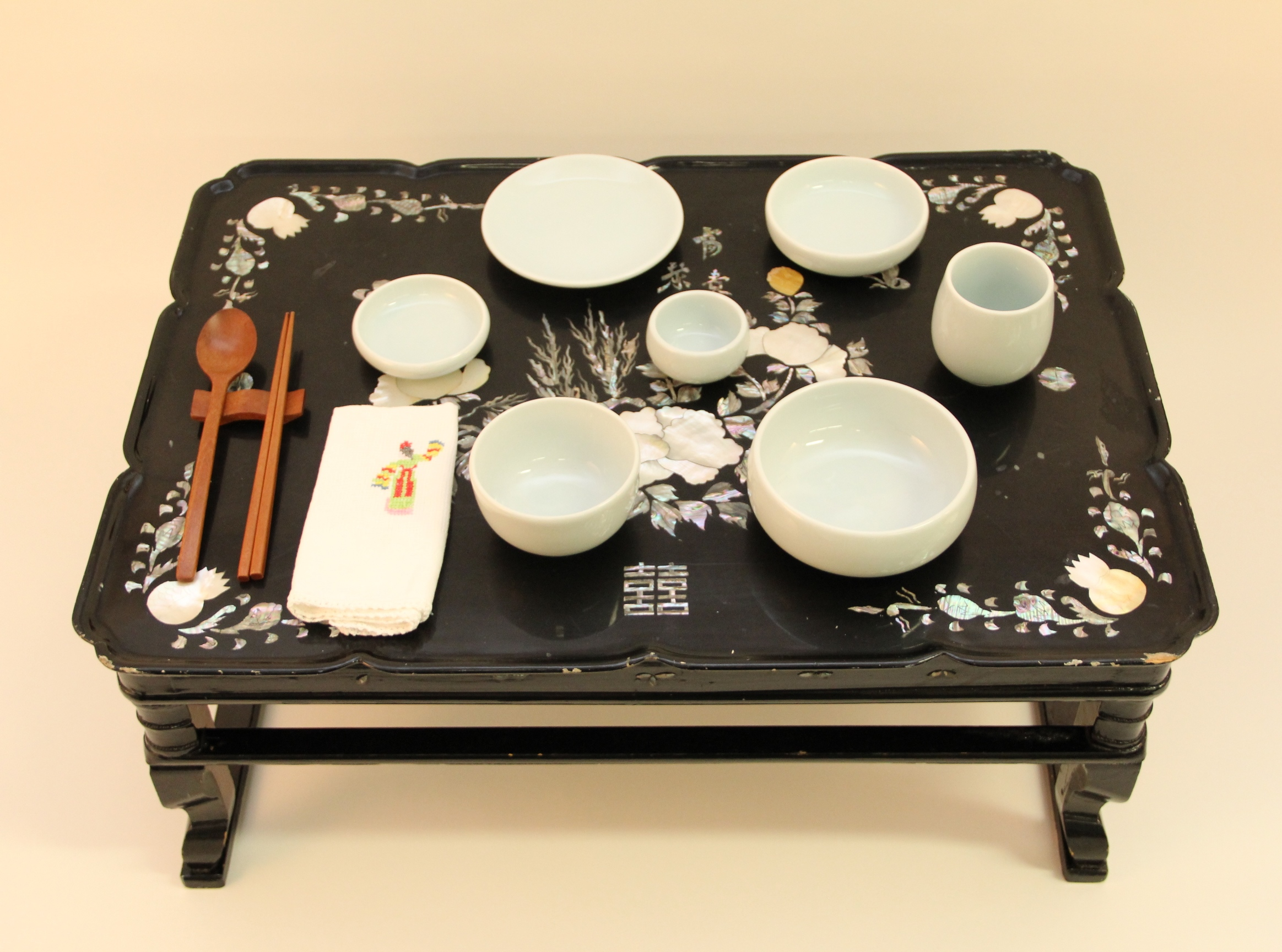 Traditional Korean tea tray with porcelain dishes