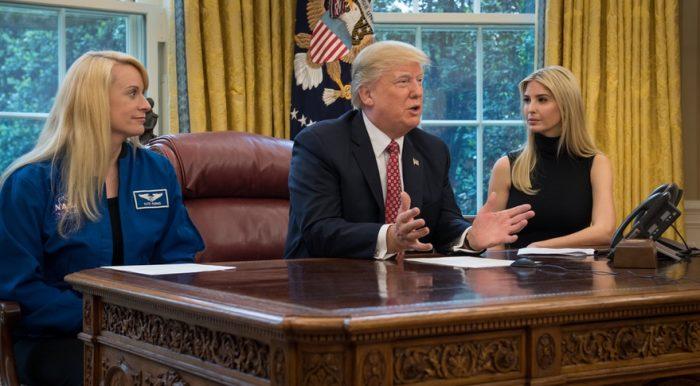 Trump at desk with Ivanka Trump and Kate Rubins