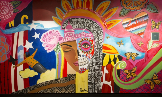 colorful mural with female head at center