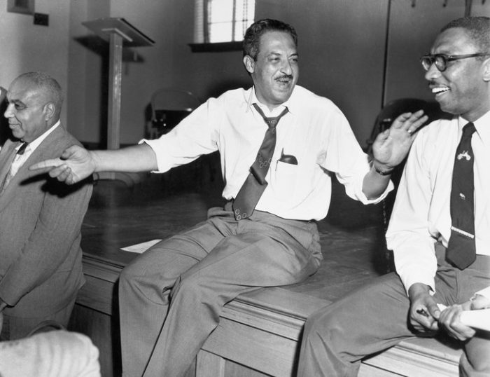 Young Thurgood Marshall sitting on a desk