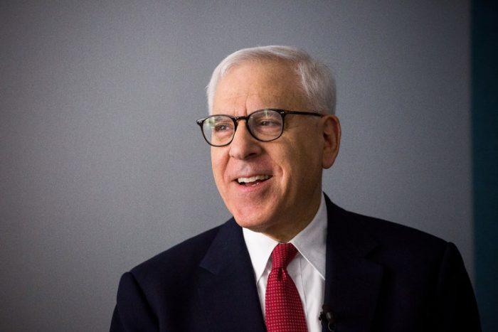 Portrait of Rubenstein against gray background