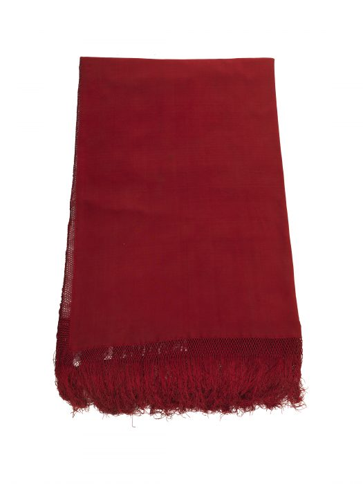 folded red shawl with fringe