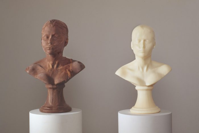 Two side-by-side busts of young boy