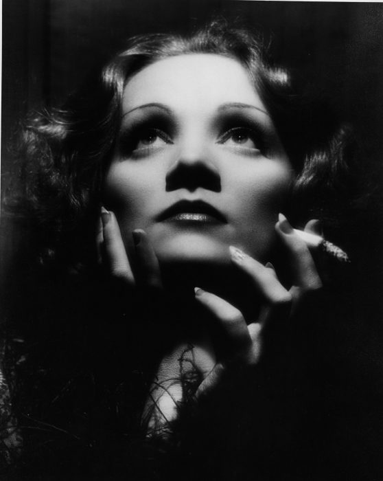 Black and white close-up of Dietrich with cigarette