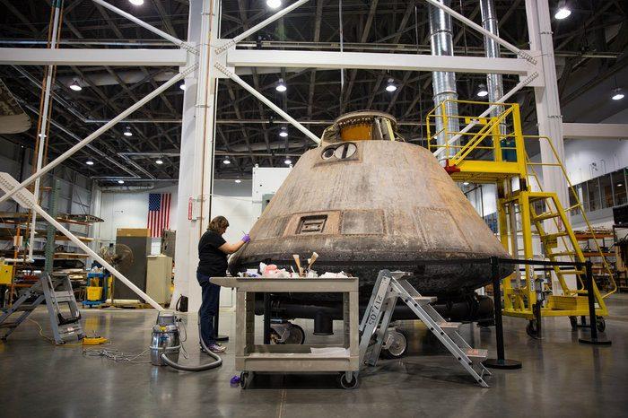 Curator working on Apollo 11 capsule