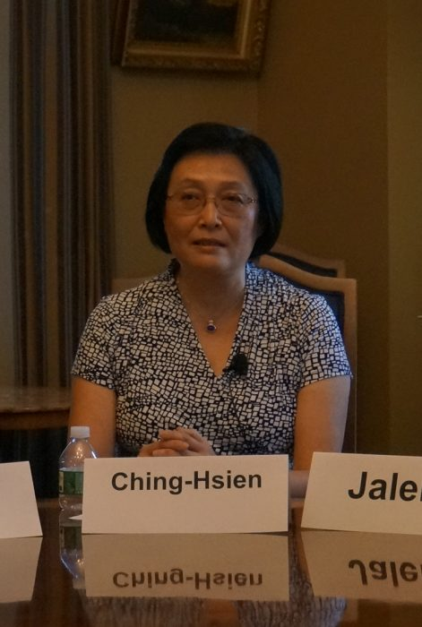 Chieng-Hsien seated at table