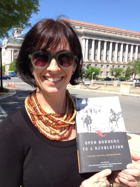 Magdalena holding copy of book