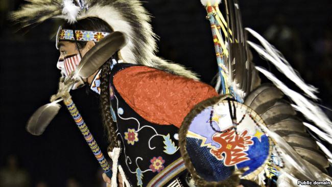 Dancer in native regalia
