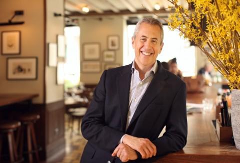Meyer poses in restaurant