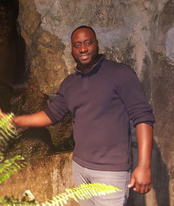 Siddiki standing in Zoo exhibit