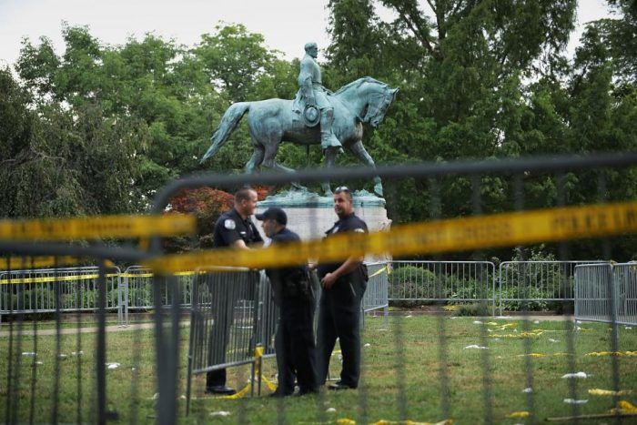 Confederate monument surroounded by barricades