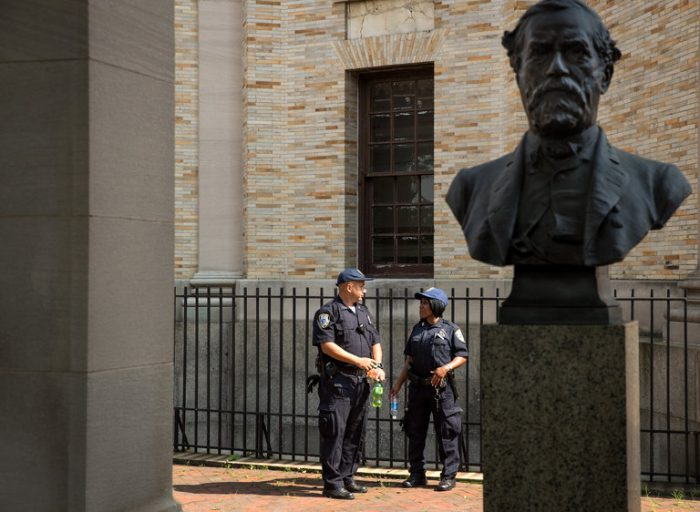 Bust of Robert E Lee with officers in background