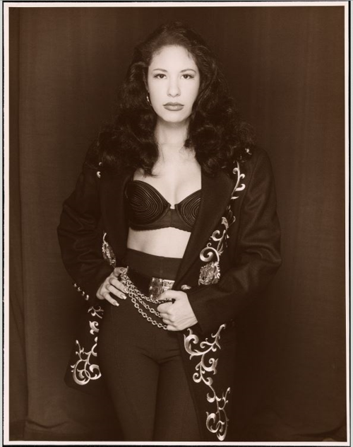 Black and white photo of singer in performance costume