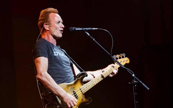 Sting playing guitar