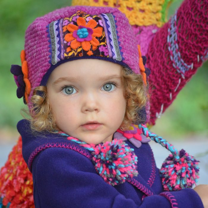 Child wearing colorful hat and jacket