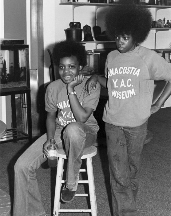 Two young people with Afros wearing YAC tshirts