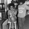 Two kids with afros wearing sweatshirts