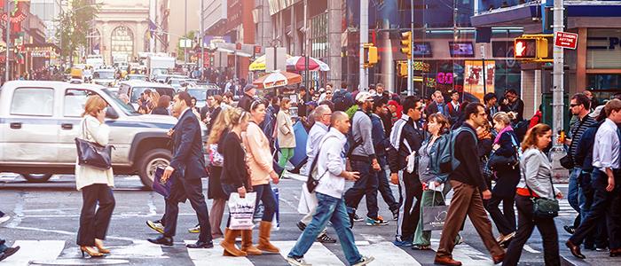 People crossing busy city street