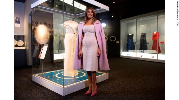 Melania Trump stands next to case with inaugural gown