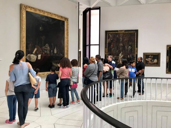 Museum visitors looking at painting