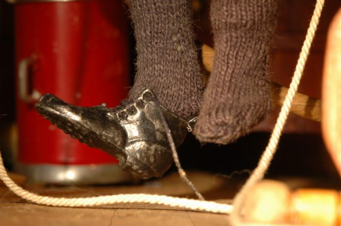 detail of doll's foot with shoe
