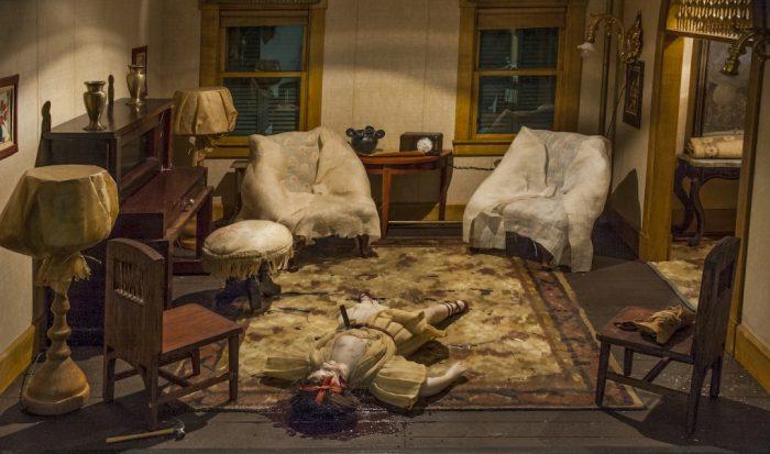 Model of murder scene with stabbed body on floor