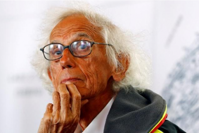 Close-up photo of artist Christo with hand on chin