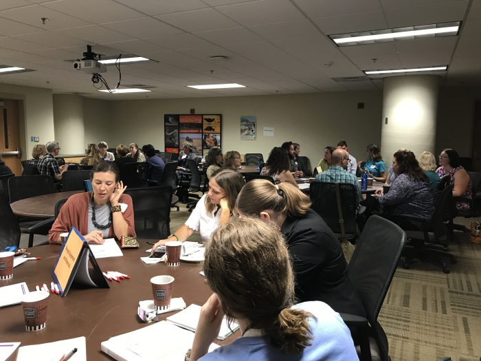 Breakout discussion groups at several tables