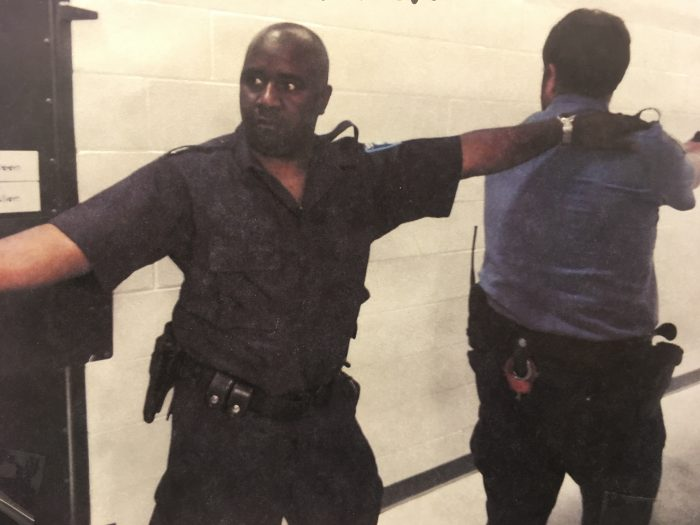 Officers with guns drawn