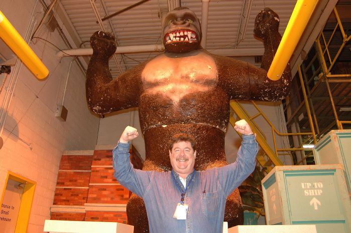 Jeff Tinsley poses in front of gorilla