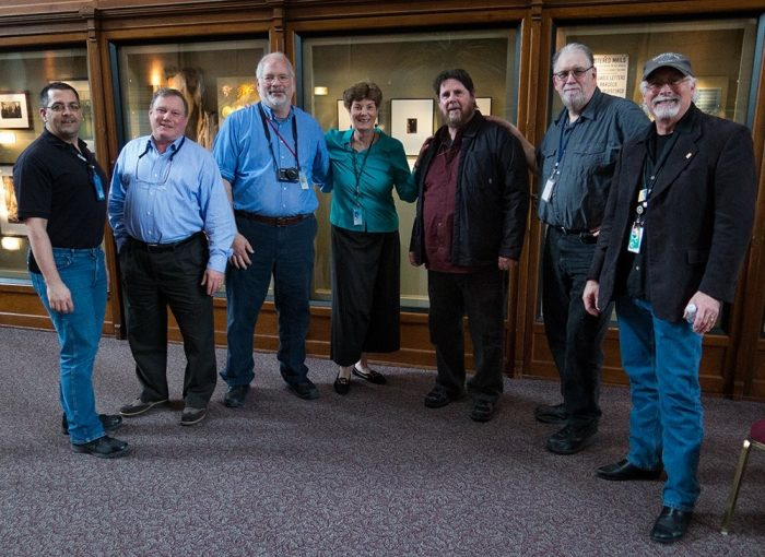 Group shot of photographers at Amy Ballard's retirement party
