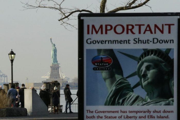 Statue of Liberty with closed sign in foreground