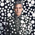 George Clooney in polk-dot suit against polka-dot background