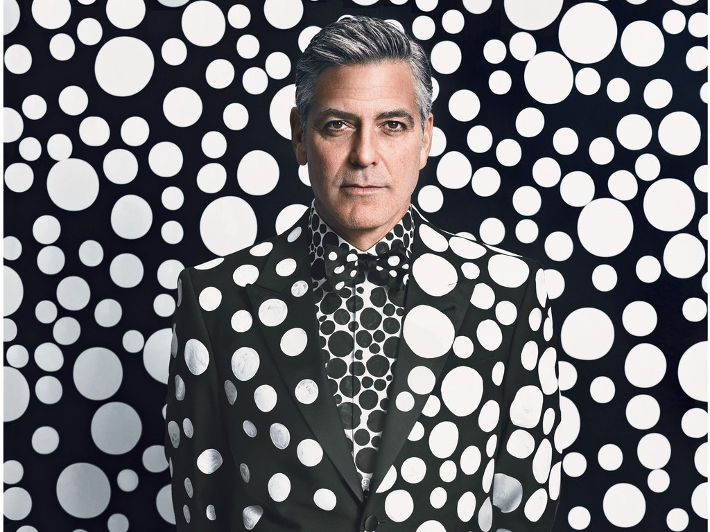 George Clooney in polk-dot suit against polka-dot background